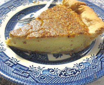slice of old-fashioned egg custard pie on a blue willow plate