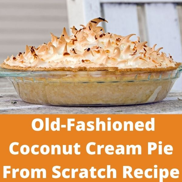 Old-fashioned coconut cream pie from scratch with meringue in glass pan