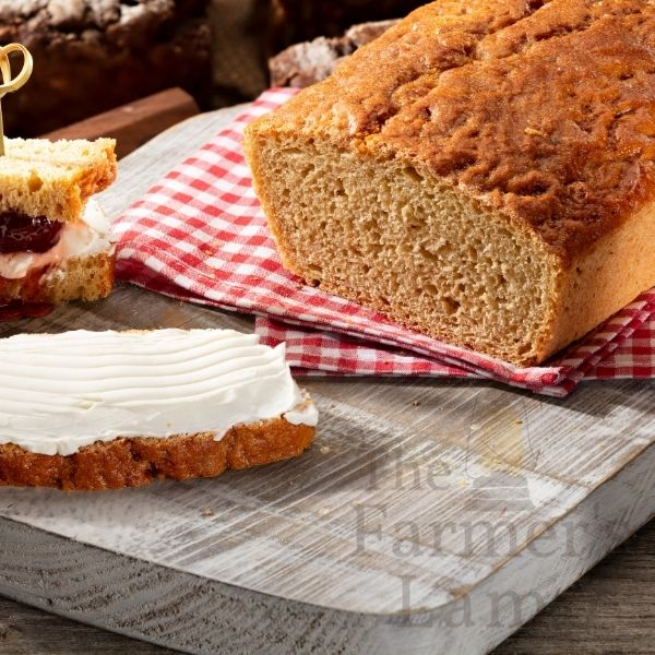 Einkorn Wheat Flour Bread loaf sliced with butter on one slice