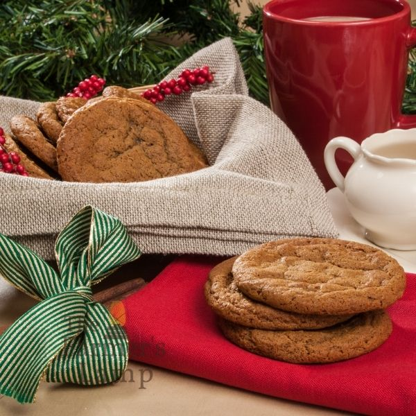 Einkorn Christmas Cookies in a bowl covered with brown burlap and a red cup filled with coffee