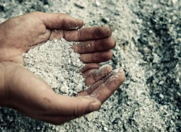 ashes in a man's hands for using wood ash
